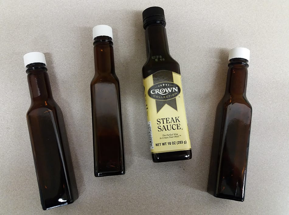 One of these things is not like the others. Avon Lake Public Library staffers found a Crown Collection Steak Sauce bottle, which they deemed a second copycat. Photo: Terra Dankowski/American Libraries