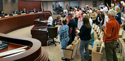 "Dozens of Escondido residents spent hours on their feet ""standing for the library"" October 18. Photo by J. Harry Jones"