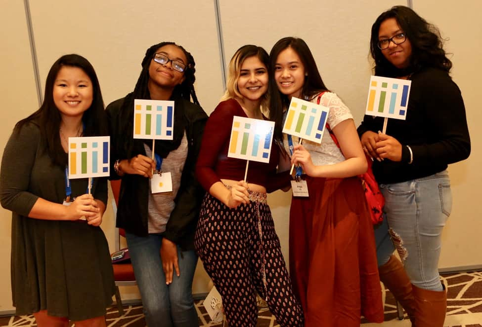 Interns pose with Inclusive Internship Initiative signs at the commencement event in Chicago on October 14. (Photo: Tori Soper)