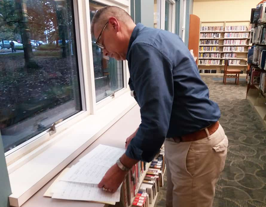 Dan Cotton, page supervisor at Avon Lake Public Library, kept copious notes during the A1 Mystery. He took Dewey Decibel on a tour of library locations where the first few bottles were found. Photo: Terra Dankowski/American Libraries