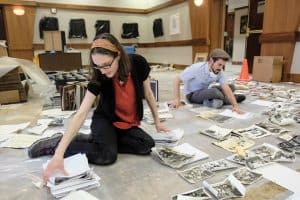 Rabbi Sarah Fort (left) helps salvage flood-damaged photo archives at Beth Yeshurun synagogue in the aftermath of Hurricane Harvey. Photo by Michael Duke/Jewish Herald-Voice
