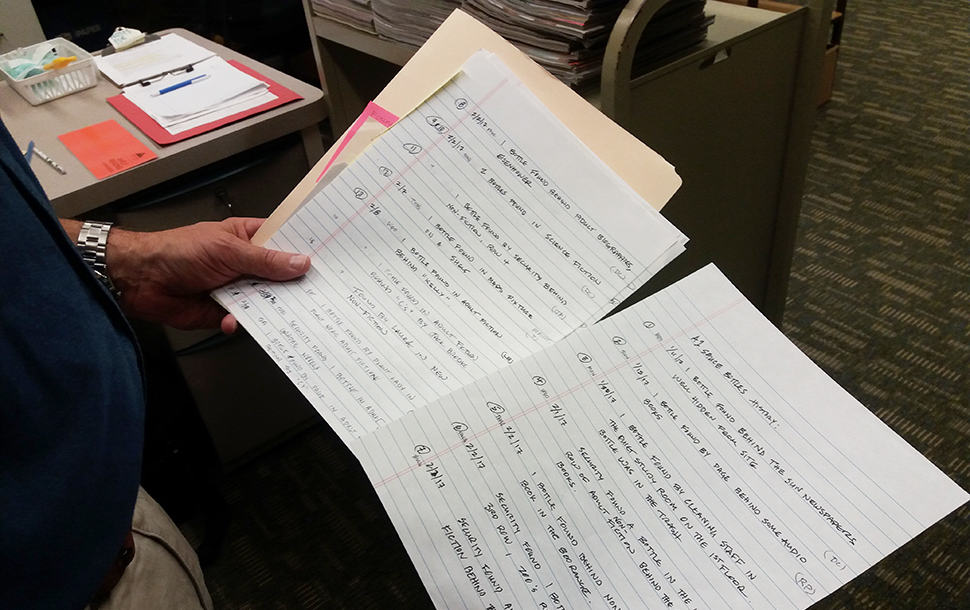 Dan Cotton, page supervisor at Avon Lake Public Library, shows off two pages from his case file. Photo: Terra Dankowski/American Libraries