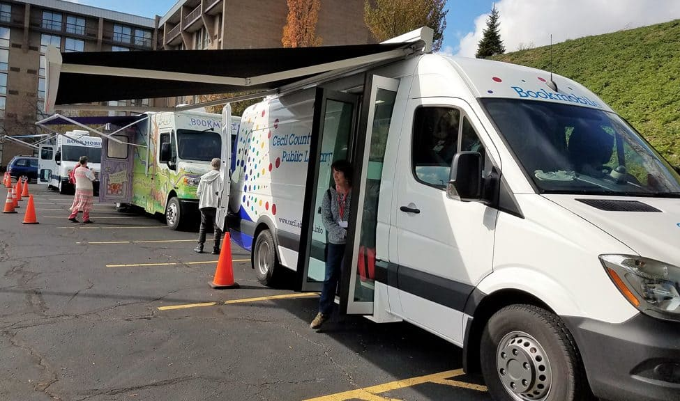 Bookmobiles on display at the Association of Bookmobile and Outreach Services conference in Pittsburgh, October 25–27, 2017.