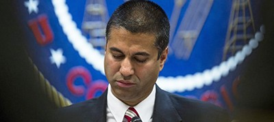 Ajit Pai, chairman of the Federal Communications Commission (FCC), pauses while speaking during an open meeting in Washington on Nov. 16. Photographer: Zach Gibson/Bloomberg