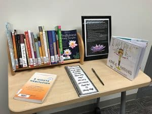 Library books housed in the Tulsa (Okla.) Community College meditation room, along with a comment book for patrons. Photo: Tulsa (Okla.) Community College.