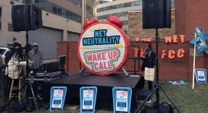 Wake Up Call rally outside the FCC offices, December 14. Photo by Emily Wagner