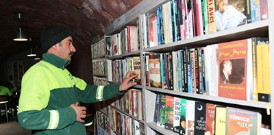 A garbage collector in Ankara browses for books at the library