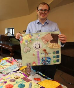David Kelsey with a fidget quilt