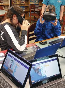 Students at Bay Shore (N.Y.) Middle School participating in a CoSpaces Hour of Code activity are able to drag and drop blocks to write their code and see it performed in VR. Photo: Kristina A. Holzweiss