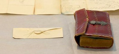 Lock of George Washington's hair and the almanac where it was discovered
