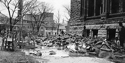 Books, destroyed in 1913 flood waters, were shoveled out of the Dayton Library