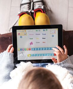 Students use ScratchJr to program the actions of characters in stories.