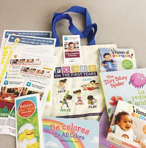 "Baltimore County (Md.) Public Library staffers distribute bags of early literacy materials to the families they serve at WIC clinics. <span class=""credit"">Photo: Baltimore County (Md.) Public Library</span>"