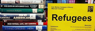 Merced College library book display on refugees