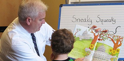 Rep. Tom Emmer (R-Minn.-6) reads to a group of children at Great River Regional Library in St. Cloud, Minnesota