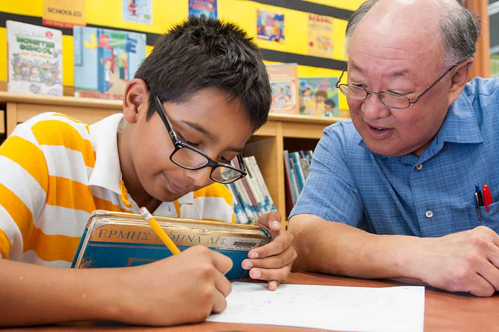 Gary Yamagiwa, a teacher with Chicago Public School's Teacher in the Library program, works with a student at Chicago Public Library's Austin-Irving branch. Photo: Chicago Public Library