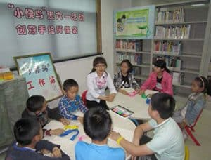 A librarian (center) with students at Suzhou Library.