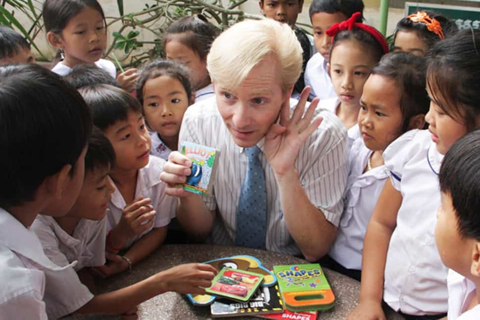 John Hickok (center) interacts with students at a school in Kandal Province, Cambodia.