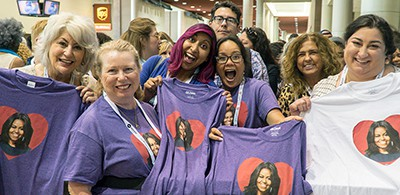 Attendees of the ALA 2018 Annual Conference in New Orleans display matching Michelle Obama T-shirts ahead of the Opening General Session