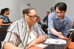 Staff members of Charlotte Mecklenburg (N.C.) Library assist seniors at a YMCA DigiLit class designed to help bridge the digital knowledge divide.Photo: Everett Blackmon