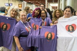 Attendees of the American Library Association's 2018 Annual Conference and Exhibition in New Orleans display matching Michelle Obama T-shirts ahead of the Opening General Session. Photos: Cognotes and Rebecca Lomax/American Libraries