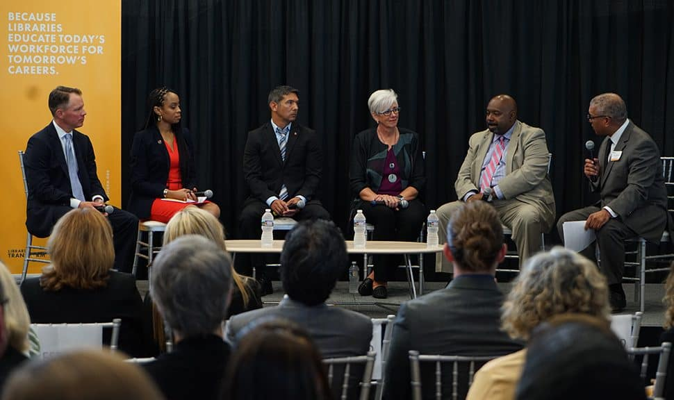 """The """"Libraries Educate Today's Workforce for Tomorrow's Careers"""" panel held on August 9 in Cleveland. From left: Ryan Burgess, director of the Governor's Office of Workforce Transformation; Shontel Brown, Cuyahoga County Council representative for district 9; Mick Munoz, a former Marine and Ohio library patron; Denise Reading, CEO of GetWorkerFIT; and Jeff Patterson, CEO of Cuyahoga Metropolitan Housing Authority; and moderator Russ Mitchell, WKYC-TV anchor and managing editor."""