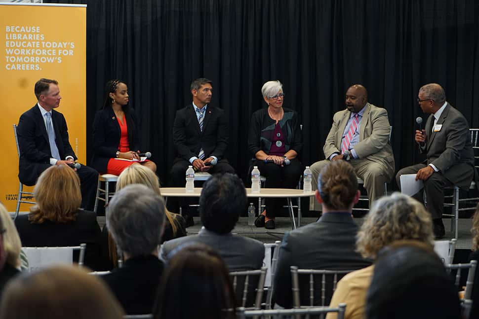 "The ""Libraries Educate Today's Workforce for Tomorrow's Careers"" panel held on August 9 in Cleveland. From left: Ryan Burgess, director of the Governor's Office of Workforce Transformation; Shontel Brown, Cuyahoga County Council representative for district 9; Mick Munoz, a former Marine and Ohio library patron; Denise Reading, CEO of GetWorkerFIT; and Jeff Patterson, CEO of Cuyahoga Metropolitan Housing Authority; and moderator Russ Mitchell, WKYC-TV anchor and managing editor."