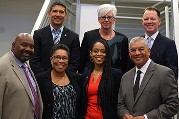 Back row, from left: Mick Munoz, Denise Reading, and Ryan Burgess. Front row, from left: Jeff Patterson, US Rep. Marcia Fudge, Shontel Brown, and Russ Mitchell.