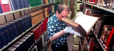 Gregory Priore at the Carnegie Library of Pittsburgh in 1999. An archivist in charge of the rare books collection, he was arrested in July on charges that he and a book dealer stole about $8 million worth of books and other items over two decades. Photo by Sammy Dallal/Pittsburgh Post-Gazette