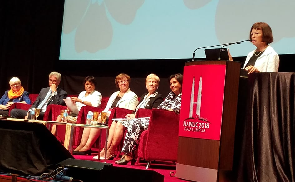 Multiple IFLA leaders take the stage in Kuala Lumpur, Malaysia. From left: Claudia Lux, IFLA Secretary General Gerald Leitner, Ellen Tise, Sinikka Sipilä, Ingrid Parent, Glòria Pérez-Salmerón, and Donna Scheeder.