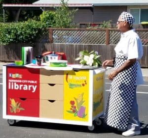"Chef Steve Cortez pushes Redwood City (Calif.) Public Library's mobile kitchen, La Cocina de Libros. <span class=""credit"">Photo: Redwood City Public Library</span>"