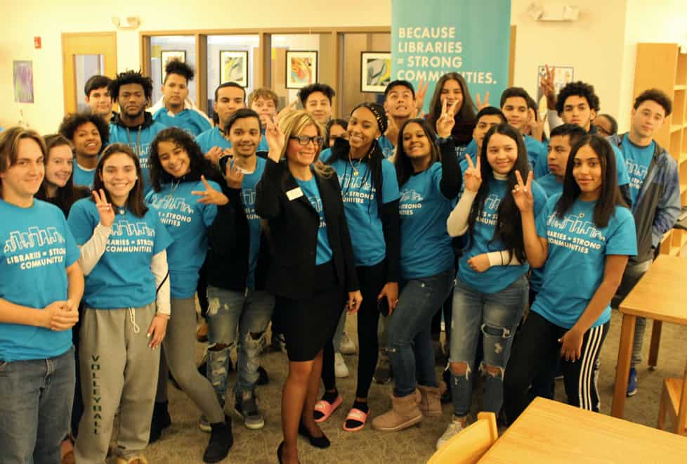 ALA President Loida Garcia-Febo (center) and students at Cranston (R.I.) High School East pose in the school's library.
