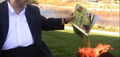 Paul Dorr, a northwest Iowa religious activist, released a Facebook Live video Friday in which he burns four LGBTQ-themed books from the Orange City Public Library. A still from the video is shown, in which he throws Suzanne and Max Lang's Families, Families, Families! into a burning barrel