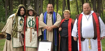 """Members of the Reformed Druids of North America (from left: Cyril; coauthor Helen Ostman; Arch-druid John """"The Verbose"""" Martens; Courtney; and Ross) mark the Autumn Equinox. Photo by John """"the Verbose"""" Martens"""