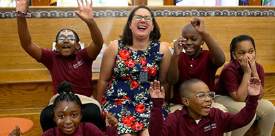 Benjamin Banneker Charter school librarian Jennifer Gordon, winner of $25,000 Milken Educator Award, with some of her students. Photo by Nancy Lane