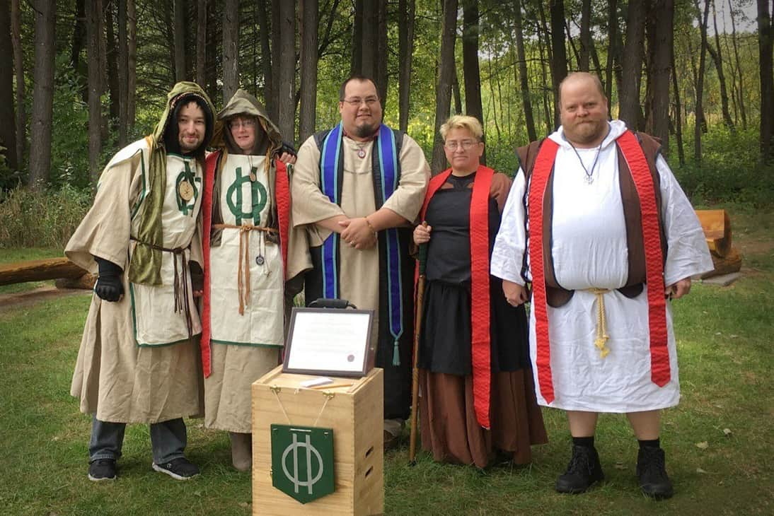 "Members of the Reformed Druids of North America (from left: Cyril; coauthor Helen Ostman; Arch-druid John ""The Verbose"" Martens; Courtney; and Ross) mark the Autumn Equinox. (Photo: John ""the Verbose"" Martens)"