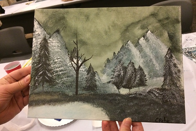 "A participant's finished painting from the ""Paint Like Bob Ross"" event at Bay County Public Library in Panama City, Florida. Photo: Sarah Burris/Northwest Regional Library System"