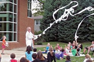 Dr. Dave demonstrates Bernoulli's principle with a leaf blower and toilet paper at Ohio State University's Whiz Bang Science Café at Worthington Libraries. Photo: Worthington (Ohio) Libraries