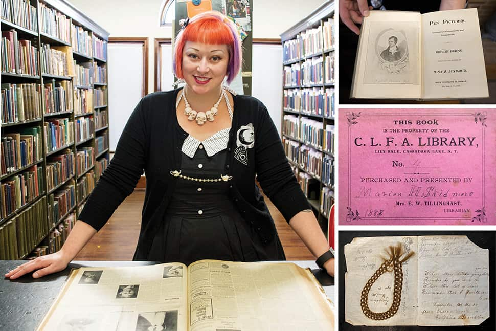Clockwise from top right: Pen Pictures, a book of channeled poetry by Robert Burns published in Lily Dale in 1900; the signature pink bookplate of Skidmore's original library, the Cassadaga Lakes Freethought Association Library; memento mori hair bracelet found inside an 1882 channeled Spiritualist text titled Oahspe; Amanda Shepp examines The Sunflower, a Spiritualist journal published in Lily Dale, 1898–1909. (Photos: Brittany Ford)