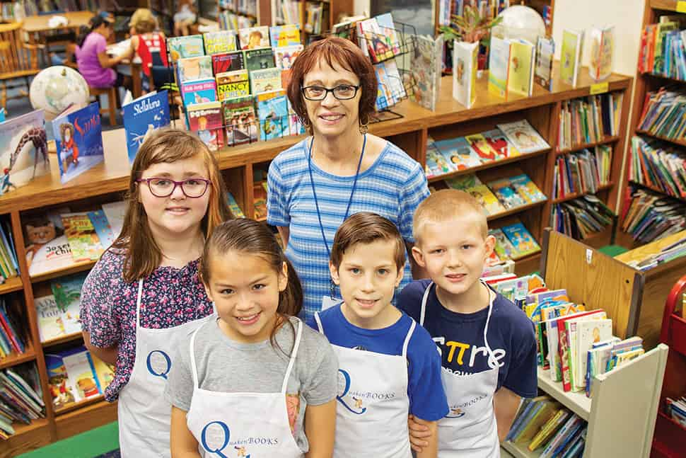 Liz Quakenbush and students at Orchard Park Elementary School in Indianapolis pose in the library.
