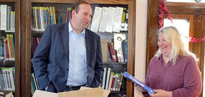 Rep. Jason Smith talks to Bone Terre Memorial Library Director Tina Johnston about the donated books. Photo by Rachel Gann / Daily Journal
