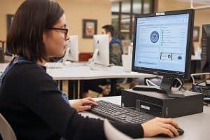 Penn State University student Luz Sanchez Tejada uses the school's microcredentialing platform in Pattee Library to earn badges as part of her peer research consultant training. Photo: Steve Tressler