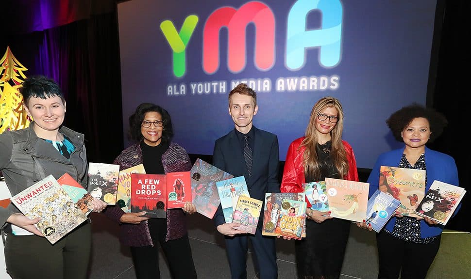 From left: YALSA President Crystle Martin, Coretta Scott King Chair Claudette McLinn, ALSC President Jamie Campbell Naidoo, ALA President Loida Garcia-Febo, and Reforma President Madeline Pena Feliz at the 2019 ALA Youth Media Awards presentation.