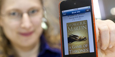Dena Heilik, department head of Philbrick Hall at the Free Library of Philadelphia, holds an ebook copy of A Game of Thrones. Photo by Ryan S. Brandenberg