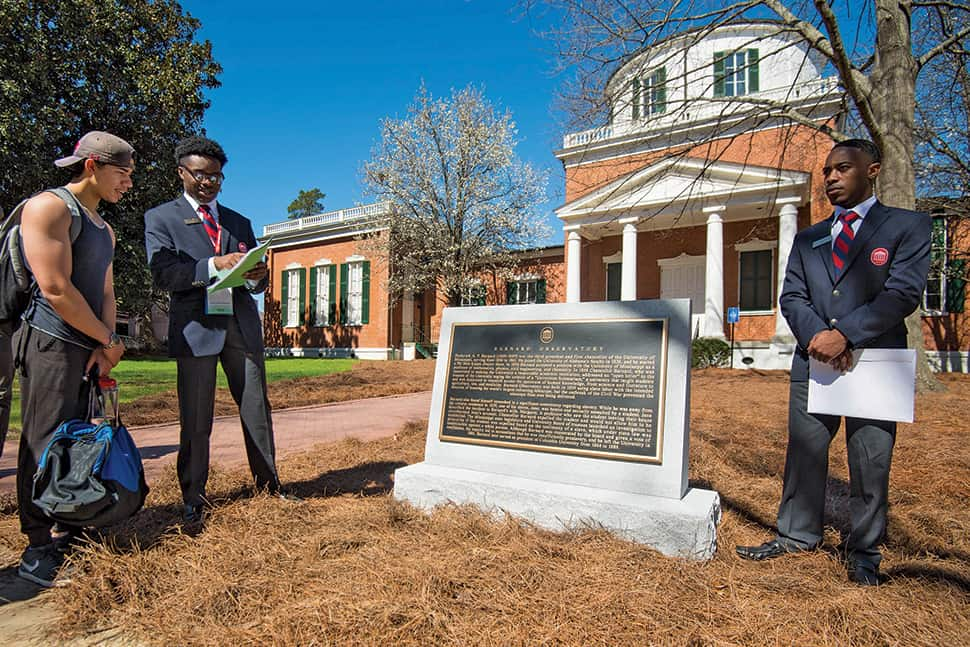 Columns Society members at University of Mississippi tell visitors about the Committee on History and Context plaque placed at Barnard Observatory.