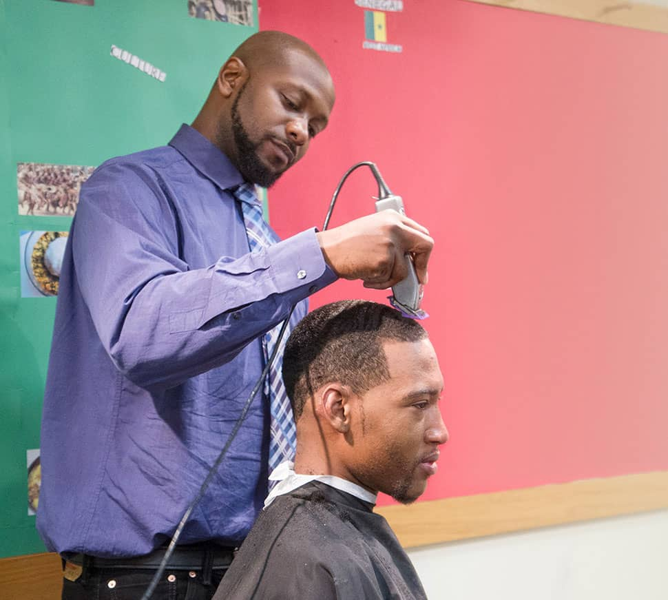 Kenneth Clayton cuts James Trautman's hair during a Barbershop in the Library event on June 20, 2016. Photo: Rebecca Lomax/American Libraries