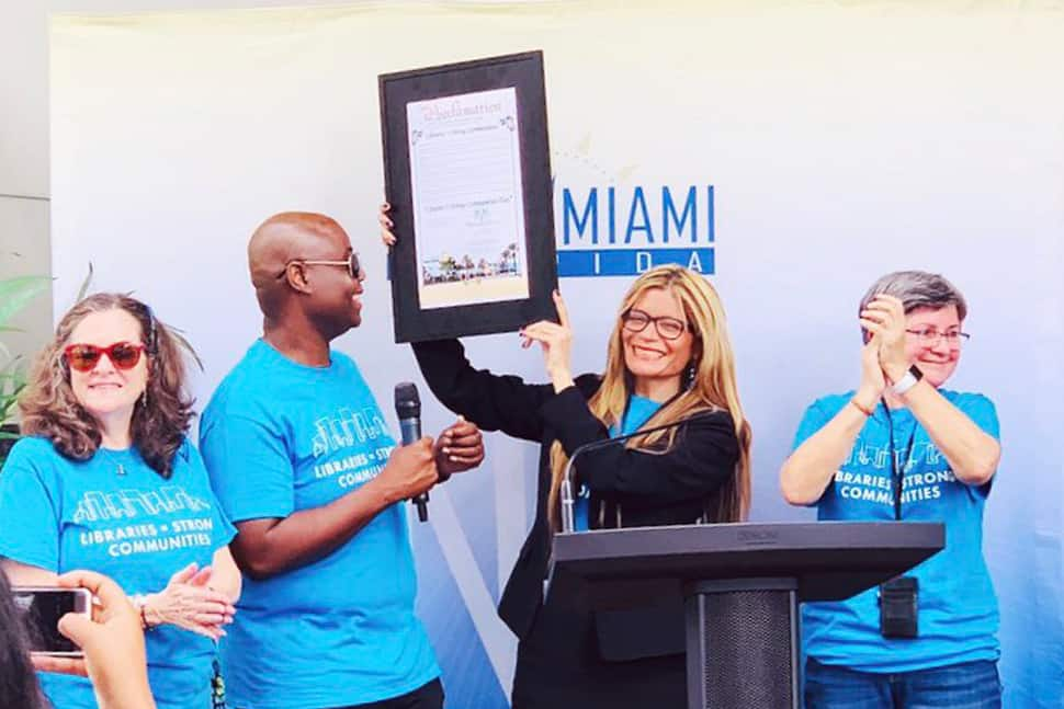 ALA President Loida Garcia-Febo holds a proclamation from the city of North Miami, Florida, during a Libraries = Strong Communities rally at North Miami Public Library February 9. From left: Councilwoman Carol Keys, Councilman Alix Desulme, Garcia-Febo, and Library Director Lucia Gonzalez.