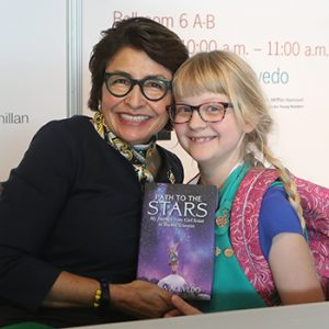 "Sylvia Acevedo poses for a photo with Girl Scout Stephanie Trier after speaking at the 2019 ALA Midwinter Meeting. <span class=""credit"">Photo: Cognotes</span>"