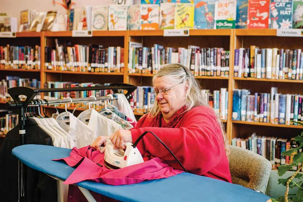 Sandra Vardell, former board member at Jane Morgan Memorial Library in Cambria, Wisconsin, volunteers one Saturday per month to tackle the town's tailoring. Photo: Katie Hunt Photography