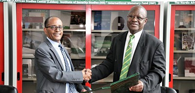 African Union Commission Director of Strategic Policy, Planning, Monitoring, Evaluation and Resource Mobilization Mesfin Tessema (left) with AfLIA President John Tsebe at the MOU signing